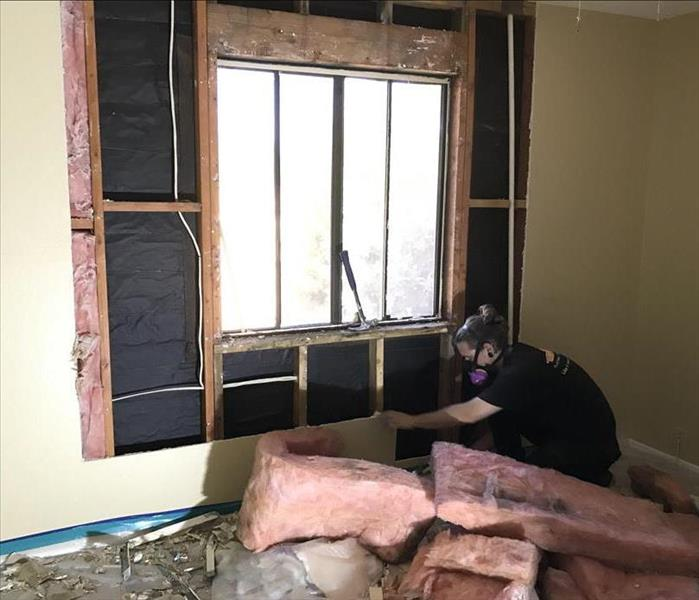 A saturated wall is cut away to allow drying to take place